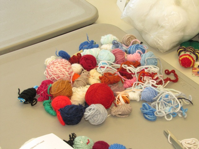 Picture 2: Vivian's jumble of bits and pieces of yarn left over from various knitting projects, perfect for the dolls.